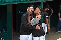 San Jose Giants pitcher John Gavin (19) and hitting coach Thomas Neal (21) goof around before a California League game against the Visalia Rawhide on April 13, 2019 at San Jose Municipal Stadium in San Jose, California. Visalia defeated San Jose 4-2. (Zachary Lucy/Four Seam Images)
