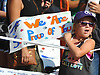 Riley James, 5, of Syosset waves a sign as she cheers on the racers of Northport's annual Cow Harbor 10-kilometer run on Saturday, September 19, 2015.<br /> <br /> James Escher