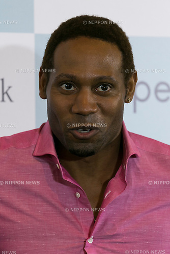 Actor Dante Carver attends a press conference to announce that the SoftBank's robot ''Pepper'' can feel like a human on June 18, 2015, Tokyo, Japan. Masayoshi Son chairman & CEO of Japanese internet and telecommunications giant SoftBank Corp., announced that its robot Pepper can feel and understand people's emotions and also express itself. Son also said that the first 1000 robots will be on sale to the public for 198,000 JPY (1,604 USD) from Saturday June 20th, and could be available to companies to replace positions such as reception and convenience store staff from the beginning of July. To develop Pepper's skills SoftBank announced an alliance with foreign technology companies FOXCONN and Alibaba Group. (Photo by Rodrigo Reyes Marin/AFLO)