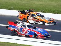 Apr 14, 2019; Baytown, TX, USA; NHRA funny car driver Robert Hight (near) races alongside Jonnie Lindberg during the Springnationals at Houston Raceway Park. Mandatory Credit: Mark J. Rebilas-USA TODAY Sports