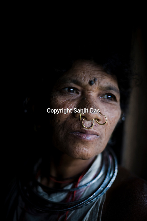 Mai Sikaka poses for a portrait outside her hut in Salpojola village in Niyamgiri hills. She is one of the many people who will get displaced if the aluminium company Vedanta carries on with its plans of mining of Bauxide in Niyamgiri hills in Rayagara district of Orissa in India.