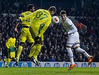 12.12.2013 London, England. Tottenham Hotspur defender Danny Rose (3) heads past Anzhi Makhachkala defender Ewerton (37) during the Europa League game between Tottenham Hotspur and Anzhi Makhachkala from White Hart Lane.