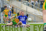 Declan O'Sullivan slides in ahead of Neil McGee Donegal during their Allainz league clash in Fitzgerald Stadium on Sunday