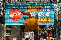 The rear end of a Pokemon balloon in front of a Mattel banner at the 113th North American International Toy Fair in the Jacob Javits Convention center in New York on Sunday, February 14, 2016.  The four day trade show with over 1000 exhibitors connects buyers and sellers and draws tens of thousands of attendees.  The toy industry generates over $84 billion worldwide and Toy Fair is the largest toy trade show in the Western Hemisphere. (© Richard B. Levine)