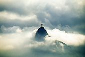Rio de Janeiro, Brazil. The Christ Statue rising out of mist and clouds.