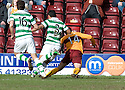 :: MOTHERWELL'S KEITH LASLEY IS BROUGHT DOWN BY CELTIC'S EMILIO IZAGUIRRE FOR MOTHERWELL'S PENALTY ::