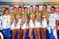 September 12, 2009; Mie, Japan;  Posing with coaches the Italian rhythmic group wins gold in group All Around at the 2009 World Championships Mie, Japan. (L-R) Romina Laurito, Elisa Blanchi, Daniela Masseroni, Anzhelika Savrayuk, Giulia Galtarossa, Elisa Santoni. Photo by Tom Theobald .