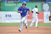 South Bend Cubs third baseman Zack Short (3) runs to third base during a game against the Burlington Bees at Community Field on May 10, 2017 in Burlington, Iowa.  The Bees won 4-3 in 10 innings.  (Dennis Hubbard/Four Seam Images)