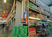 Chinese consumers buy imported food at a new metro supermarket in Kunming city, China. The 8,000 square meter super-store is attracting more and more customers who are buying imported food in bulk as their tastes are quickly changing and becoming more sophisticated.  As the chinese grow richer they.are consuming more and more food and are being partially blamed for mopping up excess food on the world food markets resulting in the world food crisis and increase in cost of staple products..27 Apr 2008