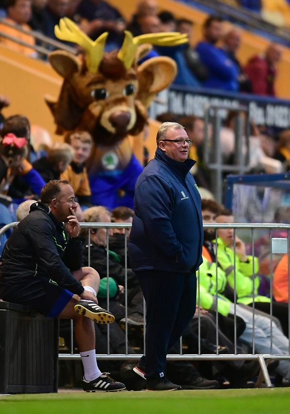 Mansfield Town manager Steve Evans with one of the club's mascots behind him<br /> <br /> Photographer Chris Vaughan/CameraSport<br /> <br /> The EFL Checkatrade Trophy - Mansfield Town v Lincoln City - Tuesday 29th August 2017 - Field Mill - Mansfield<br />  <br /> World Copyright &copy; 2018 CameraSport. All rights reserved. 43 Linden Ave. Countesthorpe. Leicester. England. LE8 5PG - Tel: +44 (0) 116 277 4147 - admin@camerasport.com - www.camerasport.com