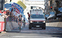 Pieter Serry (BEL/Etixx-Quickstep) is followed closely by the ambulance as he was involved in a crash on the local laps of Genova.<br /> Eventually he would finish the race but was forced to abandon the Giro as his right shoulder ligaments were torn. <br /> <br /> 2015 Giro<br /> stage 2: Albenga - Genova (177km)