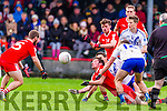 Waterville's Fionán Clifford tackled but manages to get the pass off the waiting Fergal Cronin in the South Kerry Senior Championship Semi-Final in Waterville on Saturday. Waterville 1-7 St Mary's 0-11.