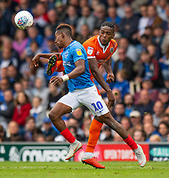 Shrewsbury Town's Omar Beckles (right) battles with Portsmouth's Jamal Lowe (left) <br /> <br /> Photographer David Horton/CameraSport<br /> <br /> The EFL Sky Bet League One - Portsmouth v Shrewsbury Town - Saturday September 8th 2018 - Fratton Park - Portsmouth<br /> <br /> World Copyright &copy; 2018 CameraSport. All rights reserved. 43 Linden Ave. Countesthorpe. Leicester. England. LE8 5PG - Tel: +44 (0) 116 277 4147 - admin@camerasport.com - www.camerasport.com