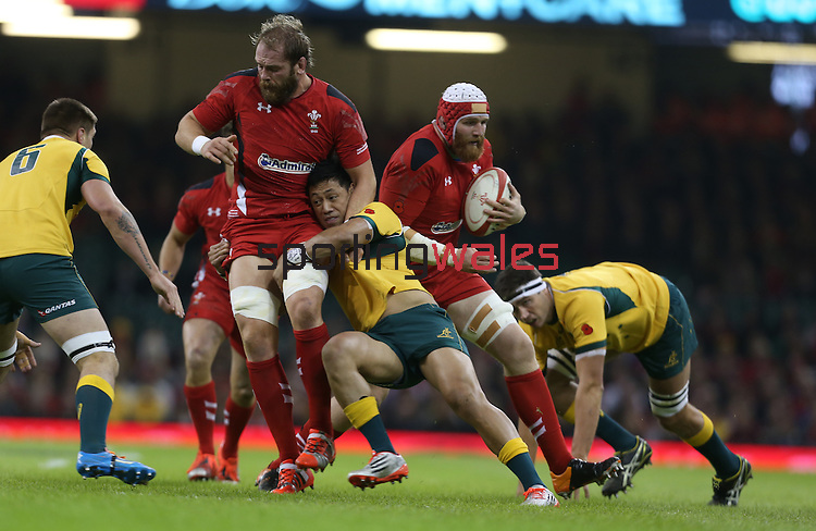 Australian centre Christian Leali'Ifano tackles Wales lock Alun Wyn Jones allowing Jake Ball to run around behind.<br /> Dove Men Series 2014<br /> Wales v Australia<br /> Millennium Stadium<br /> 08.11.14<br /> ©Steve Pope-SPORTINGWALES