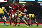 Australian centre Christian Leali'Ifano tackles Wales lock Alun Wyn Jones allowing Jake Ball to run around behind.<br /> Dove Men Series 2014<br /> Wales v Australia<br /> Millennium Stadium<br /> 08.11.14<br /> ©Steve Pope-SPORTINGWALES