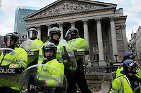Police in riot gear group together outside the Royal Exchange as thousands of protestors descended on the City of London ahead of the G20 summit of world leaders to express anger at the economic crisis, which many blame on the excesses of capitalism.