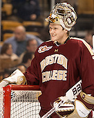 """Thatcher Demko (BC - 30) smiles at the BU student section's """"Ugly Goalie"""" chant. - The Boston College Eagles defeated the Boston University Terriers 3-1 (EN) in their opening round game of the 2014 Beanpot on Monday, February 3, 2014, at TD Garden in Boston, Massachusetts."""