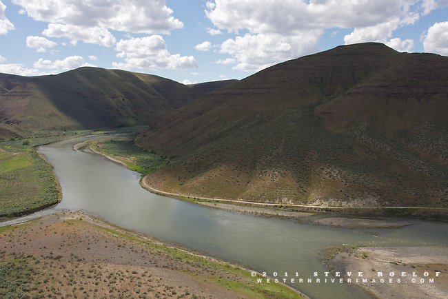 The John Day River below spring clouds, Oregon.