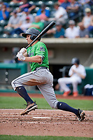 Gwinnett Stripers center fielder Peter Bourjos (5) hits an infield single during a game against the Columbus Clippers on May 17, 2018 at Huntington Park in Columbus, Ohio.  Gwinnett defeated Columbus 6-0.  (Mike Janes/Four Seam Images)
