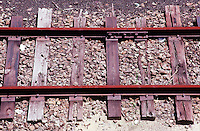 RUST<br /> Railroad Tracks<br /> Oxide of iron formed by corrosion, an electrochemical reaction.  In moist conditions iron is rapidly oxidized by oxygen to form rust, a mixture of iron oxides.