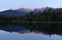 The subtle hue of sunset on Franconia Ridge enhances the grandeur of Lonesome Lake in this October image.