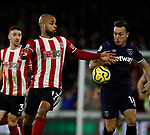 Mark Noble of West Ham United challenges David McGoldrick of Sheffield Utd during the Premier League match at Bramall Lane, Sheffield. Picture date: 10th January 2020. Picture credit should read: Simon Bellis/Sportimage