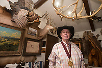 NWA Democrat-Gazette/BEN GOFF @NWABENGOFF<br /> Bunky Boger poses for a photo Thursday, Dec. 28, 2017, at his home in Lowell. Boger is wearing the medal he recieved as an inductee into the National Rodeo Hall of Fame in November at the National Cowboy &amp; Western Heritage Museum in Oklahoma City, Okla.