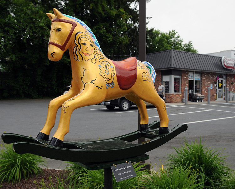 "A view of ""Animation Creation,"" created by Amy Stypulkoski, by the Stewarts Shop on Main Street, one of the ""Rockin' Around Saugerties"" theme Statues on display throughout the Village of Saugerties, NY, on Friday, June 9, 2017. Photo by Jim Peppler. Copyright/Jim Peppler-2017."