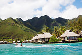 FRENCH POLYNESIA, Moorea. A boat ride with the Intercontinental Moorea Resort and Spa in the background.