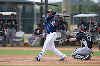 Jason Pineda (30) of the San Diego Padres follows through on his swing during an Instructional League game against the Chicago White Sox on September 26, 2017 at Camelback Ranch in Glendale, Arizona. (Zachary Lucy/Four Seam Images)