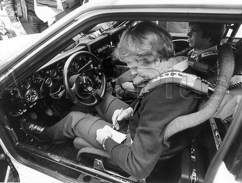 22.01.1984 Bad Homburg, Germany. Title favourite Hannu Mikkola (L) from Finnland, with his co-pilot Arne Hertz (r) in their Audi Quattro, signs autographs shortly before the start of the 51st Rally Monte Carlo in Bad Homburg, Germany, 22 January 1983.