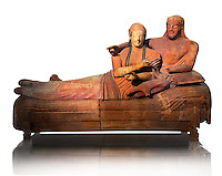 6th century BC Etruscan Sarcophagus known as The Sarcophagus of the Spouses, the in sculpted in clay by the sculptors of Caere, 520-510 BC,  Louvre Museum, Paris.  White Background. To license for Advertising usage contact The Louvre Paris