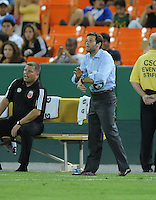 DC United Head Coach Ben Olsen yields at the team to hurry at the end of the game.  FC. Dallas defeated DC United 3-1 at RFK Stadium, Saturday August 14, 2010.