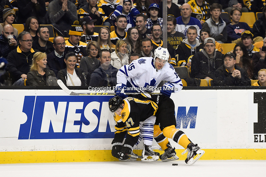 Saturday, November 21, 2015: Toronto Maple Leafs right wing P.A. Parenteau (15) and Boston Bruins defenseman Torey Krug (47) in game action during the National Hockey League game between the Toronto Maple Leafs and the Boston Bruins held at TD Garden, in Boston, Massachusetts.  Eric Canha/CSM