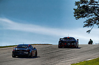#76 Compass Racing, McLaren GT4, GS: Matt Plumb, Paul Holton leads #28 RS1, Porsche Cayman GT4 MR, GS: Dillon Machavern, Spencer Pumpelly at the start