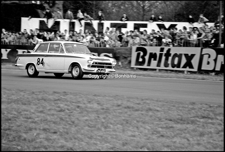 BNPS.co.uk (01202 558833)Pic: Bonhams/BNPS<br /> <br /> Oulton Park in 1965.<br /> <br /> A classic Ford Cortina that was raced by legendary Formula 1 racing driver Jim Clark, has emerged for sale for a record-breaking price of £250,000.<br /> <br /> The sporty two-door classic was twice used by the iconic driver in the 1965 British Saloon Car Championships and was also raced by some of the finest domestic drivers of the time.<br /> <br /> It was campaigned by Team Lotus, who helped to develop the racing version of the Cortina alongside Ford, and it was for them that Clark got behind the wheel.<br /> <br /> It is thought the two-time F1 world champion was impressed by the performance of the Ford-Lotus, which he raced at both Silverstone and Brands Hatch.<br /> <br /> The car was sold eventually by Lotus in 1967 and went on to fall into a state of disrepair before it was salvaged and restored in the early 2000s. <br /> <br /> It has now emerged for sale with Bonhams Auctions who have given it a pre-sale estimate of between £200,000 and £250,000.
