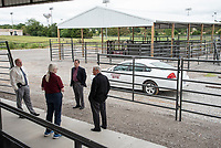 Dr Kent Hoblet, Dr. Amelia Wollums, and Dr. McLaughlin show House Representative, Mac Huddleston, newly constructed cate research pens used for cattle veterinary procedures and holding.