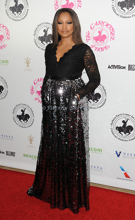 Garcelle Beauvais arriving at The 2016 Carousel Of Hope Ball held at the Beverly Hilton Hotel Beverly Hills California October 8, 2016.