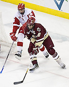John Mitchell 10 of the University of Wisconsin guards against Brian Boyle 10 of Boston College next to the Wisconsin net. The Boston College Eagles defeated the University of Wisconsin Badgers 3-0 on Friday, October 27, 2006, at the Kohl Center in Madison, Wisconsin in their first meeting since the 2006 Frozen Four Final which Wisconsin won 2-1 to take the national championship.<br />