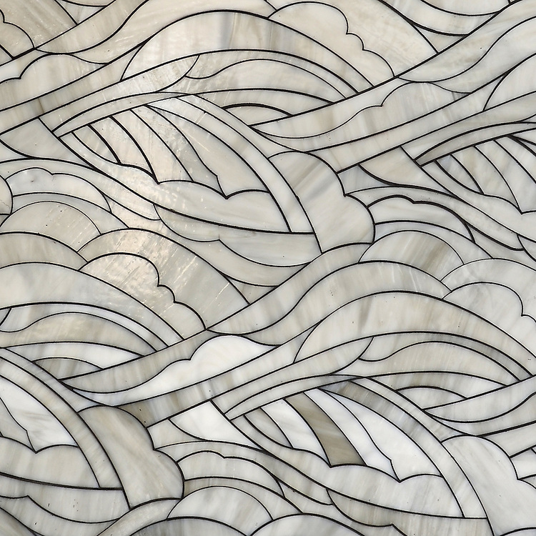 Kelp Forest, a waterjet jewel glass mosaic, shown in Alabaster, is part of the Shades of Gray Collection designed by New Ravenna.