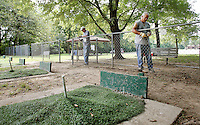 NWA Democrat-Gazette/DAVID GOTTSCHALK   Bob Cadwallader (cq) (right) and Jim Anderson, both with the Northwest Arkansas Horseshoe Pitching Association, replace a bar on perimeter fencing at the AHPA Horseshoe Pitching Complex at Walker Park in Fayetteville Tuesday, August 18, 2015. General maintenance is being performed to prepare the complex for the Arkansas Horseshoe Association 2015 State Championships taking place September 5-7.