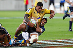 Hurricanes' Alapati Leiua, left, is taken to ground by ACT Brumbies' prop Scott Sio, right, in the Super Rugby match at Westpac Stadium, Wellington, New Zealand, Friday, March 07, 2014. Credit: Dean Pemberton