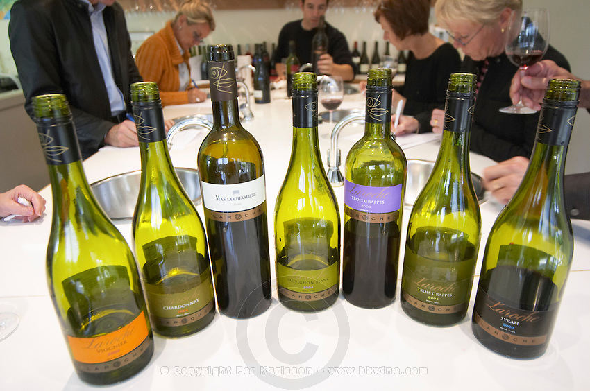Laroche Viognier, Chardonnay, Sauvignon Blanc, Trois Grappes, Syrah on a tasting room white table top. Mas La Chevaliere. near Beziers. Languedoc. Tasting wine. France. Europe. Bottle. In the professional tasting room.