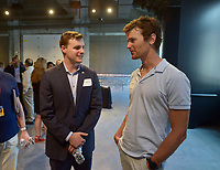 NWA Democrat-Gazette/BEN GOFF @NWABENGOFF<br /> Austin McCollum (left), state representative from Bentonville, and Steuart Walton chat Monday, June 12, 2017, during a reception hosted by the Walton Family Foundation at Record in downtown Bentonville. Members of the Walton family talked about their vision for the foundation's future work in Northwest Arkansas and abroad.