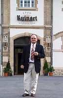 Jean-Philippe Moulin, Cellar Master or Chef de Cave, tasting one of the wines he has made outside the main building, Champagne Ruinart, Reims, Champagne, Marne, Ardennes, France