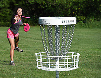 NWA Democrat-Gazette/J.T. WAMPLER  Itzy Galvan ((CQ)) practices putting Tuesday June 5, 2018 at J. Beast Disc Golf Course at J.B. Hunt Park in Springdale.
