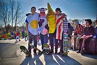 Four boys wearing costumes composing a breakfast at Halloween skateboarding event at Westerville Skate Park.