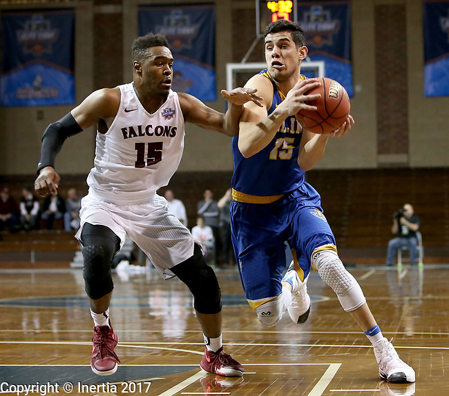 SIOUX FALLS, SD: MARCH 22: Eric Castaneda #15 from Rollins tries to get a step past Vonte Montgomery #15 from Fairmont State during the Men's Division II Basketball Championship Tournament on March 22, 2017 at the Sanford Pentagon in Sioux Falls, SD. (Photo by Dave Eggen/Inertia)