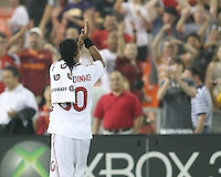 Ronaldinho #80  of A.C. Milan salutes the fans at the end of an international friendly match against D.C. United at RFK Stadium, on May 26 2010 in Washington United won 3-2.