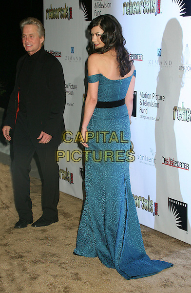 "MICHAEL DOUGLAS & CATHERINE ZETA JONES.2nd Annual ""A Fine Romance"" Benfit for the Motion Picture & Television Fund at Sunset Gower Studios, Hollywood, California, USA,.18 November 2006..full length blue dress teal off the shoulder black waistband married husband wife.CAP/ADM/BP.©Byron Purvis/AdMedia/Capital Pictures."